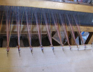 The new warp is tied onto the apron, ready for weaving.