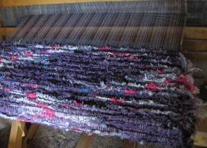 This is a shag rug waiting to be cut off the loom and the tabbies sewn.