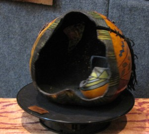 This gourd was cut open and decorated inside & outside by Eye of the Beholder.