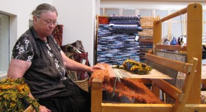 Here is Sandy Voss of Cabin Textiles at her loom at the Festival.