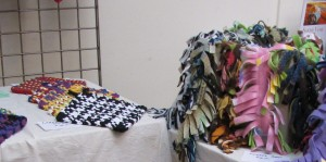 Potholders & scarves by Some Enchanted Weavings.