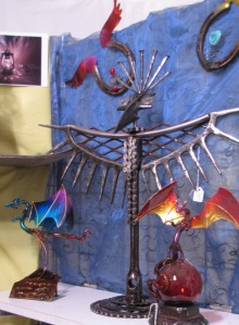 Candelaria's Art - a few dragons, a winged horseshoe, and perhaps a Thunderbird?