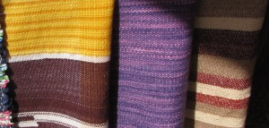Woven wraps by TDLT Fiber Artists.