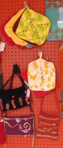 Purses & potholders by TDLT Fiber Artists.