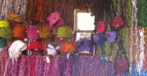 Skeins, hats, and purses by Lisa Joyce Designs.