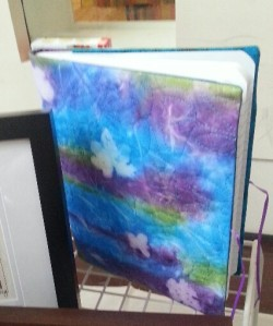 Quilted notebook cover by SW Women's Fiber Arts Collective.