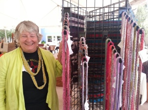 Kathy Konecki with her knitted decorative scarves