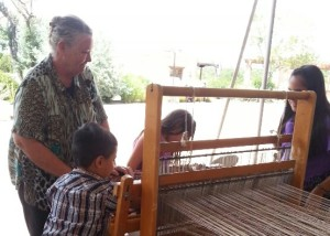 Sandy Voss teaching kids how to weave.