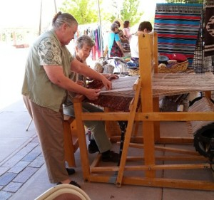 Sandy Voss teaching weaving.